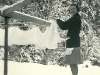 Cassiar Cannery-1940-Ed Eyford - Irene Eyford hanging laundry in the winter