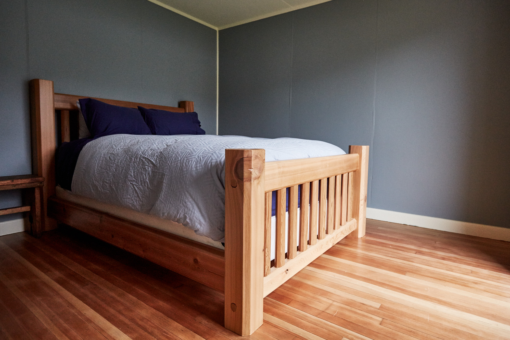 Cassiar Cannery - Halibut House-master bedroom reclaimed cedar bed