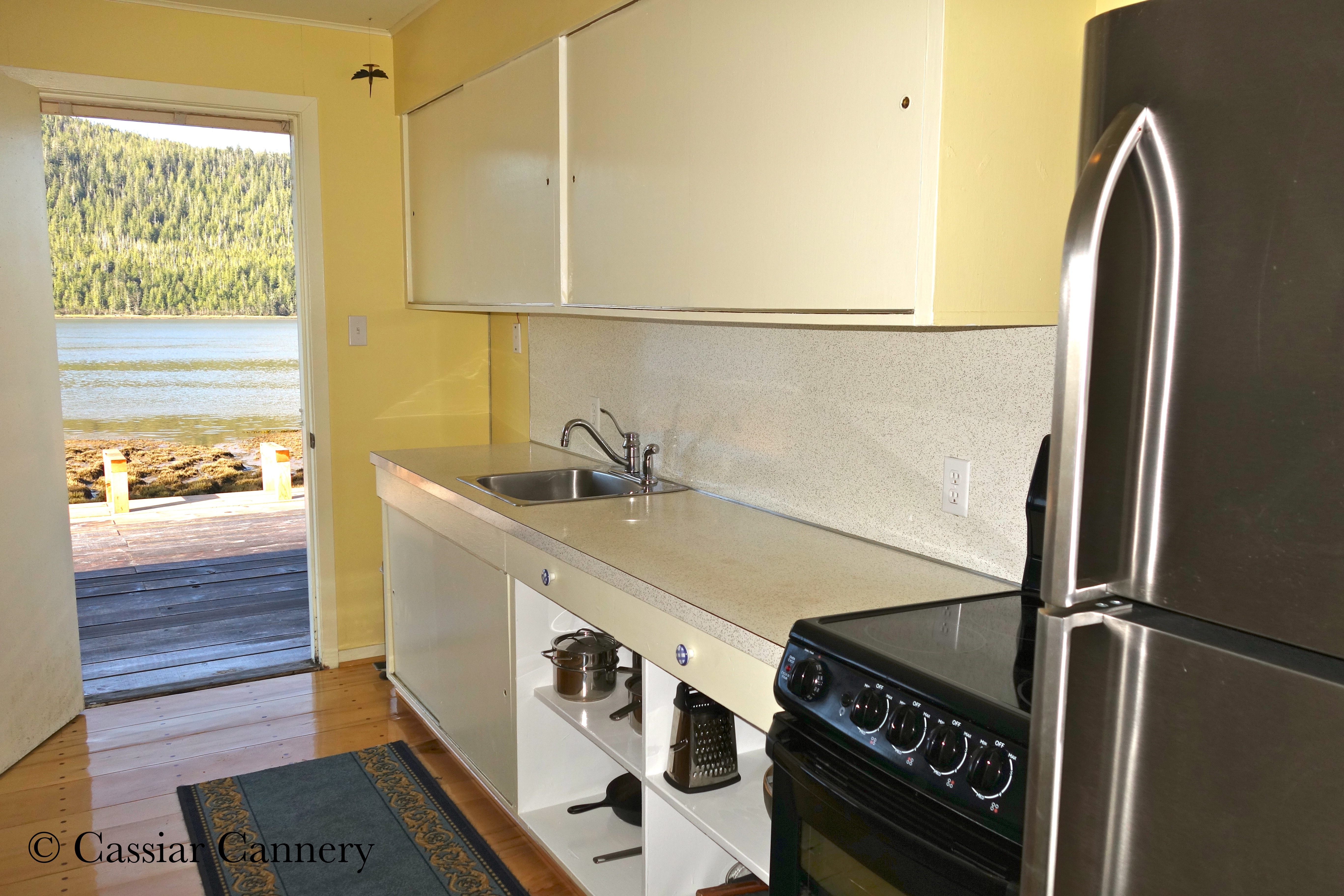 Cassiar Cannery - Steelhead House - galley style kitchen with new appliances