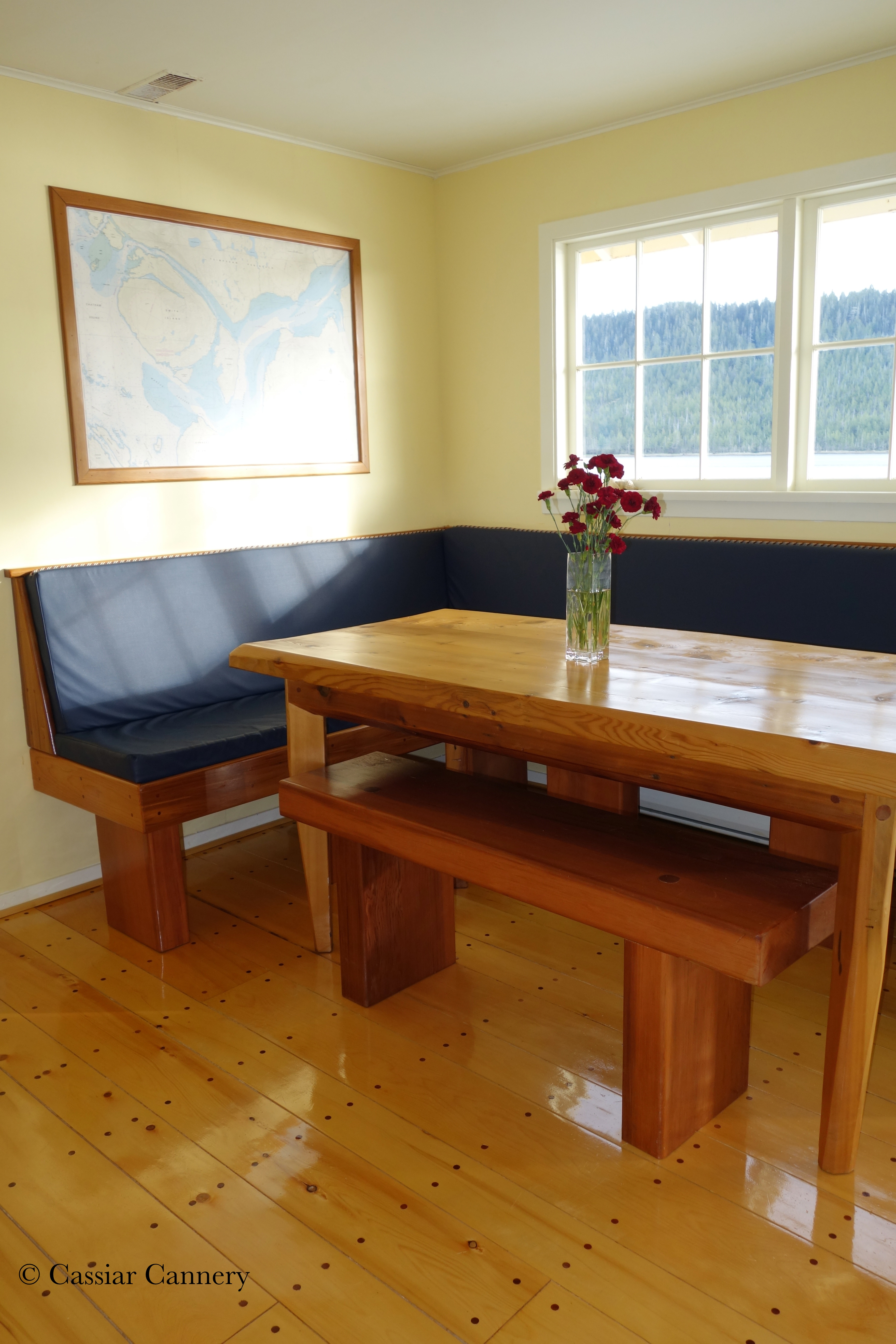 Cassiar Cannery - Steelhead House - beautiful reclaimed wood table and built in seating area- plenty of room!
