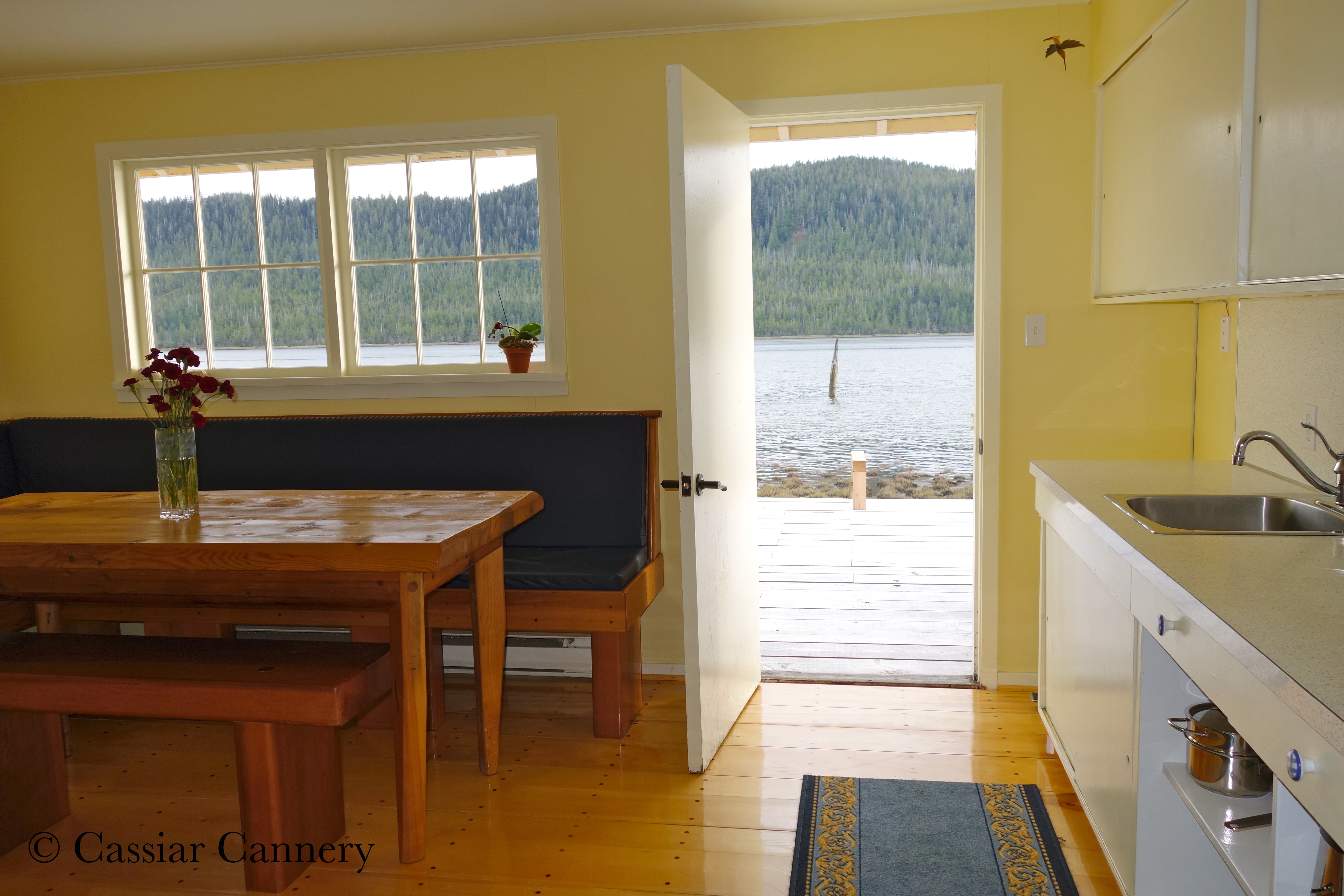 Cassiar Cannery - Steelhead House - galley style kitchen and eating area