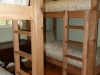 Cassiar Cannery - Steelhead House - two sets of twin bunk beds with luxury linens in the back bedroom