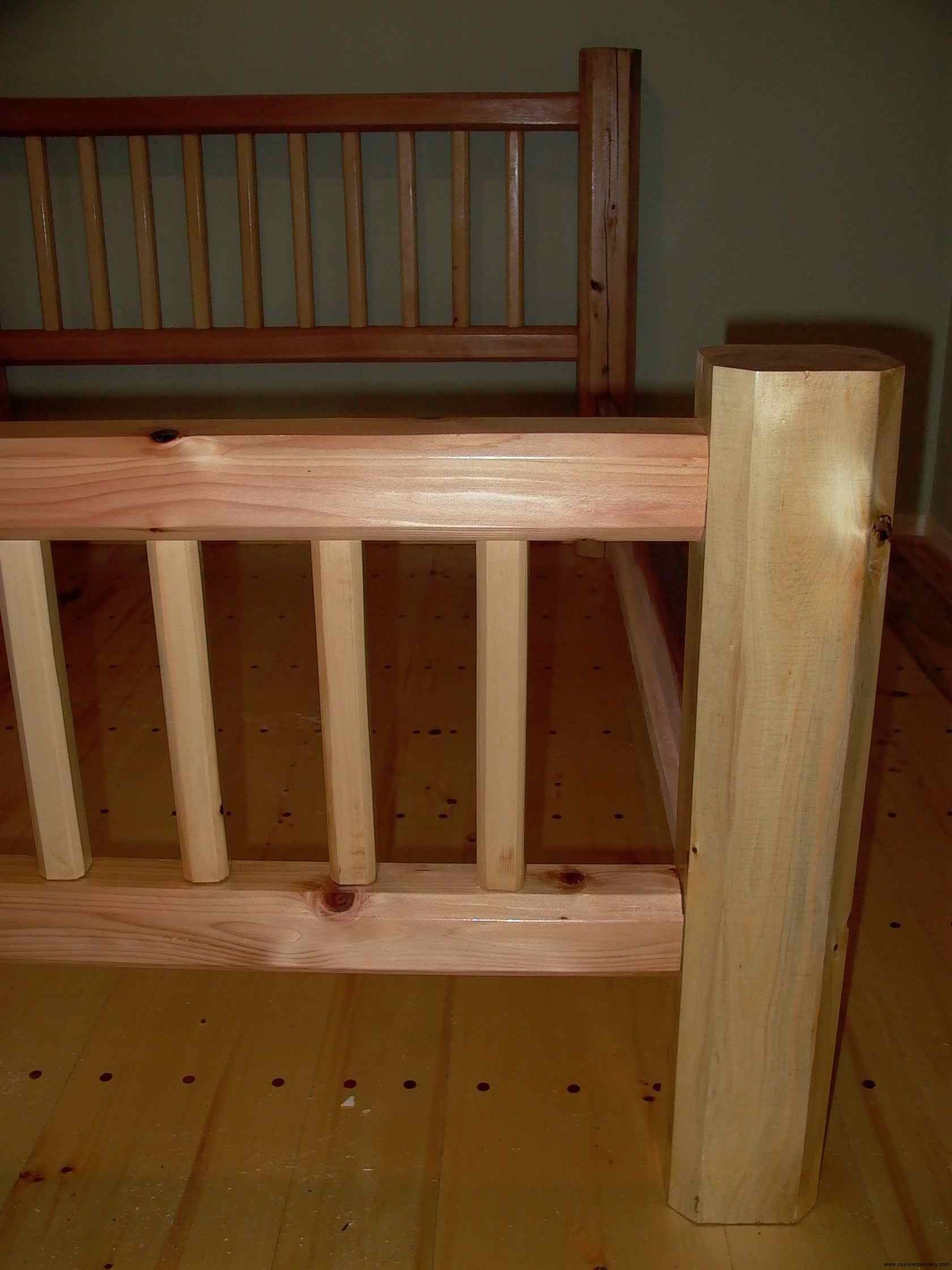 Cassiar Cannery - custom woodwork - queen bed frame of reclaimed red cedar with yellow cedar accents